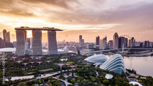 Canvas Print Aerial drone view of Singapore city skyline at sunset