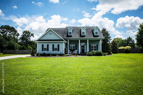 Blue Traditional Siding House Home in Suburbs Front Facing with Curb Appeal Fototapeta