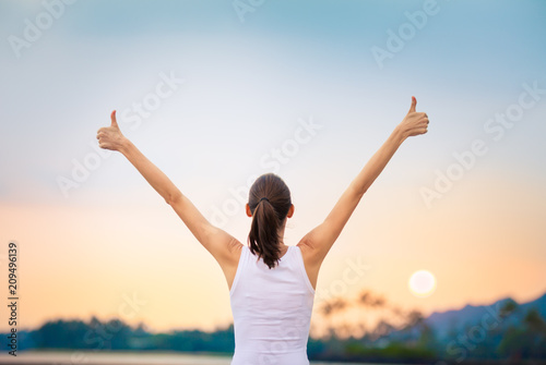 Young woman feeling happy and positive. Motivational concept.