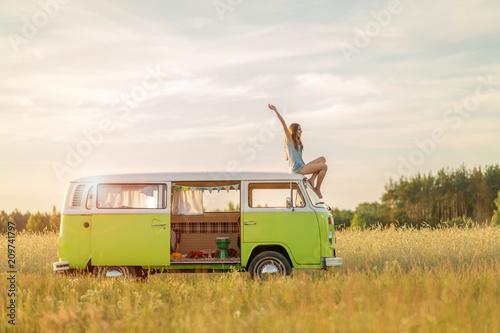 Leinwand Poster Young woman enjoying a roadtrip