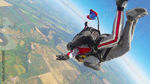 Fotografie, Obraz Skydiving tandem jumping out of a plane