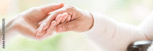 Obraz na plátně Close-up of tender gesture between two generations