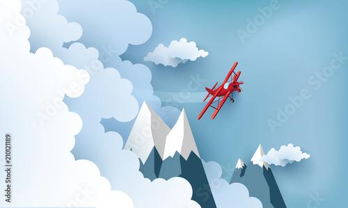 ilustracja samolotu nad chmurami i górami.