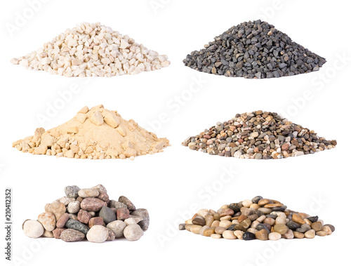 Fotografia Piles of various gravel, stones and pebbels isolated on white background