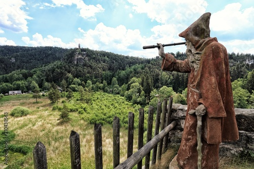 Statue of hermit with the monocular looking to the landscape Fototapeta
