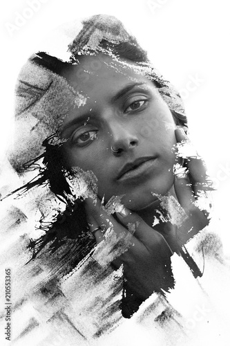 Paintography. Double Exposure portrait of a seductive ethnic woman's profile combined with hand drawn ink painting created using unique technique. black and white