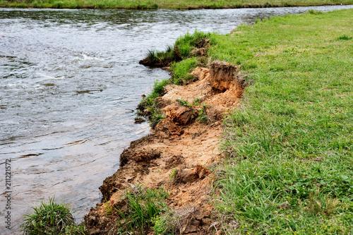 Soil erosion on a creek bank Fototapet