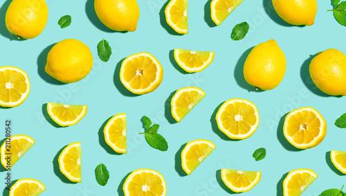 Fotografie, Obraz Fresh lemon pattern on a bright color background flat lay