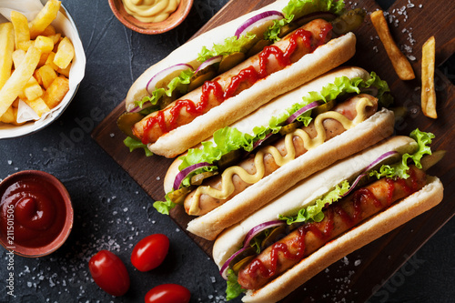 Obraz na plátně Barbecue grilled hot dog with sausage and yellow mustard with ketchup top view