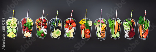 Stampa su Tela Food ingredients for blending smoothie or juice on painted glass over black chalkboard