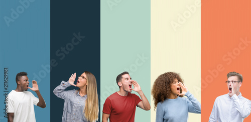 Fényképezés Group of people over vintage colors background shouting and screaming loud to side with hand on mouth