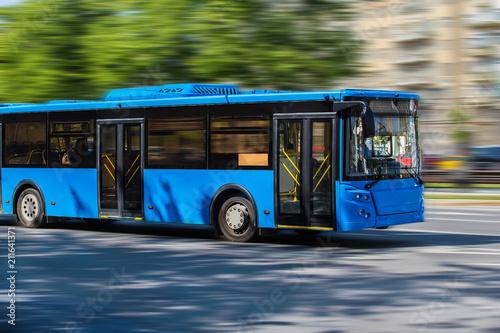 Canvas Print city bus goes along street