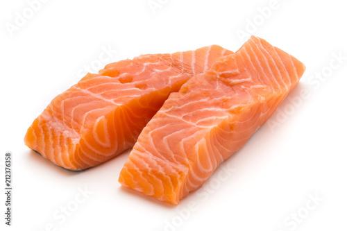 Fotografia Fresh salmon fillet with basil on the white background.