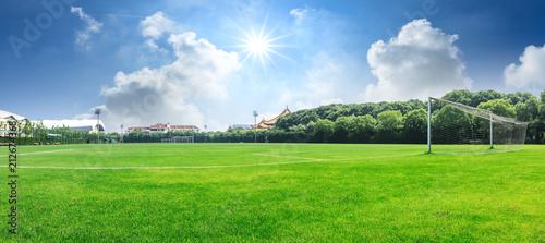 Tablou Canvas Green football field under blue sky background