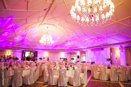 Tablou Canvas photo interior is a refined banquet hall with purple and pink light