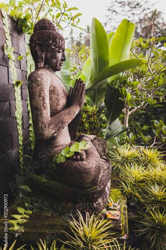 Big ancient stone Buddha statue in balinese garden