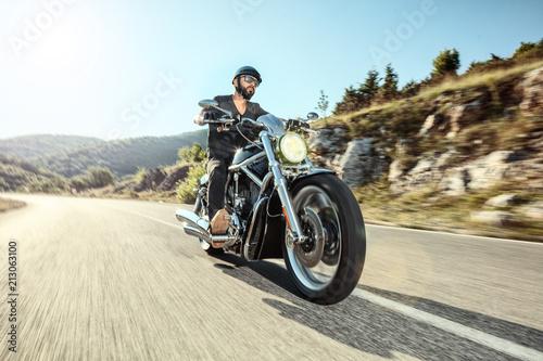 Fényképezés Young man riding a motorbike