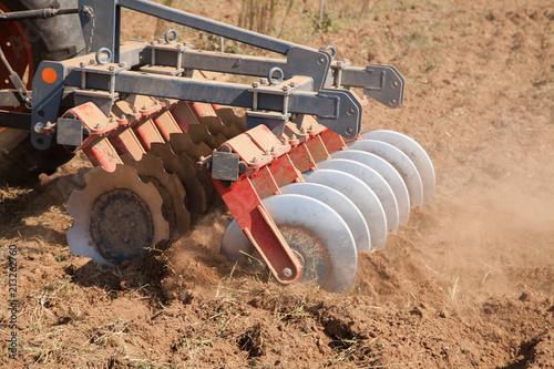 Fototapeta Close up of a disc harrow system, cultivate the soil
