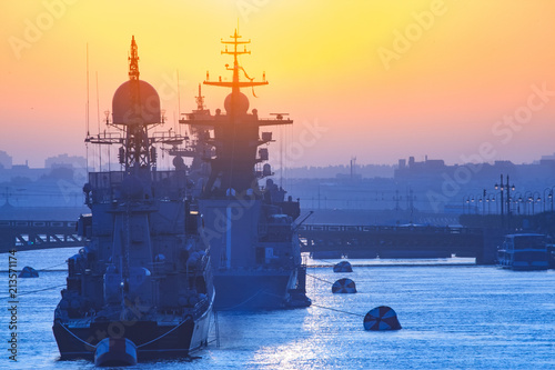Warships. Rocket cruiser. Warships in the sun. Military cruisers against the background of the city.
