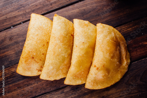 Fried empanadas, stuffed with chicken and meat