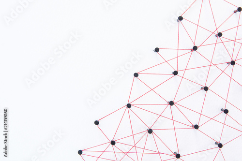 Foto Connecting networks concept - network connected with yarn red on white paper with copy space