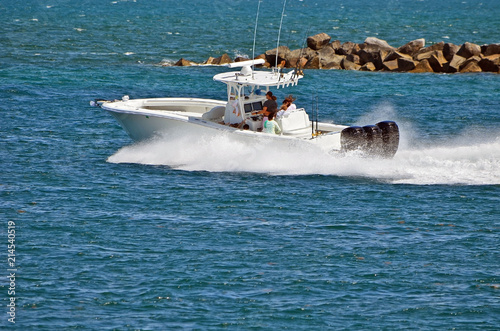 Fishing boat exiting Government Cut in miami,Florida headed towards the open ocean.