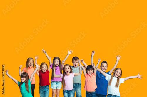 Happy success teensl celebrating being a winner. Dynamic energetic image of happy children