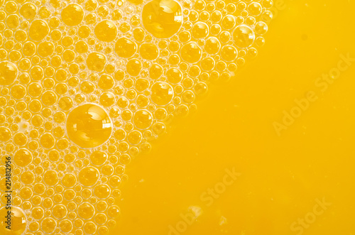 Fotografia Orange juice bubbles macro texture health fresh