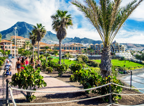 People walking along seafront promenade. Tenerife. Spain Fototapeta