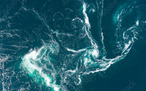 Fototapeta Abstract water currents, rapids and whirlpools in fjord
