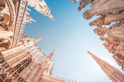 Fototapeta view of Gothic architecture and art on the roof of Milan Cathedral (Duomo di Mil