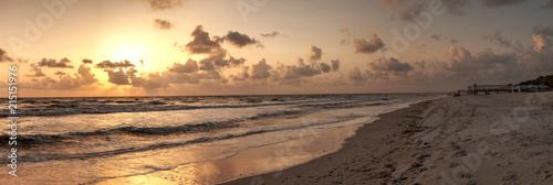 Wallpaper Mural Golden sunset over the white sand of Clam Pass Beach