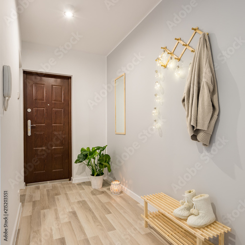 Tableau sur Toile Entryway with wooden shoe bench
