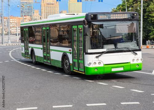 city bus goes along street