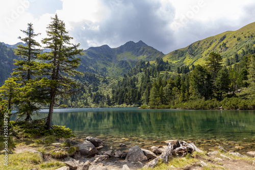Canvas Print mountain lake scheibelsee, in the background mountain great boesenstein in styri