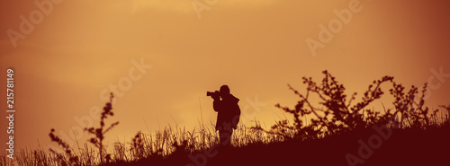 Stampa su Tela photographer takes pictures in the wild. Web banner.
