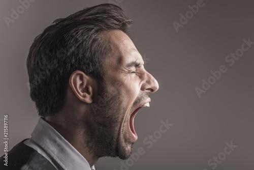 Furious angry young business man shouting and yelling, side view and closeup Tapéta, Fotótapéta