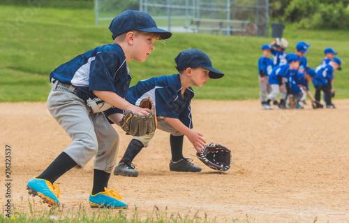 Youth Baseball Players Fielding Ground Balls