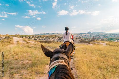 horse riding Cappadocia, woman horse riding Kapadokya Turkey Fototapet