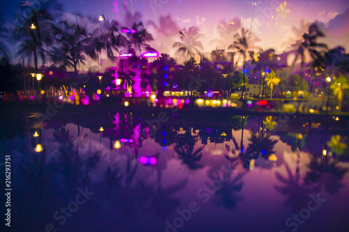 Canvas-taulu Abstract multiple-exposure view at dusk of palm trees and neon lights of Ocean D