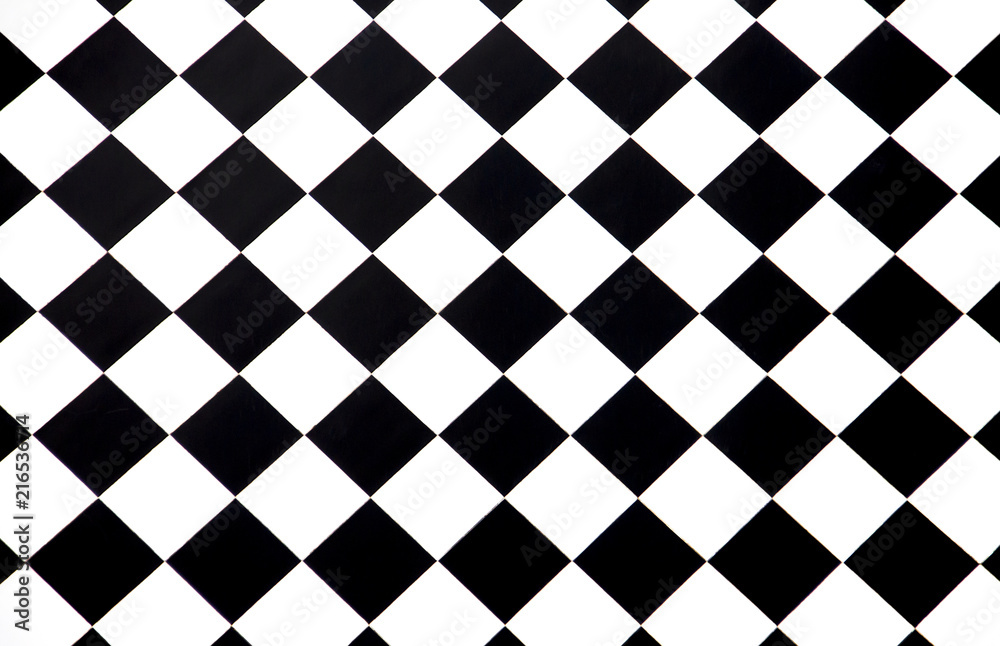 Black and white checkered floor tiles seamlessly as a pattern, top view