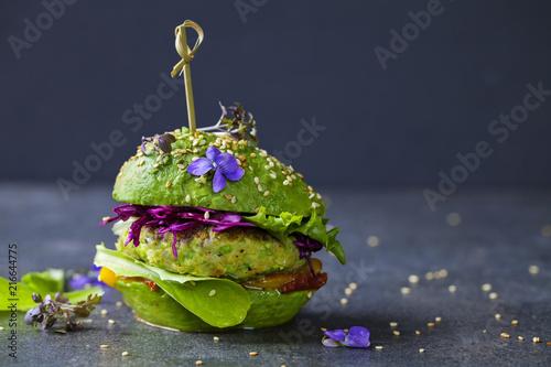 Obraz na płótnie Avocado sandwich with green vegan burger,  roast yellow pepper and pickled red c