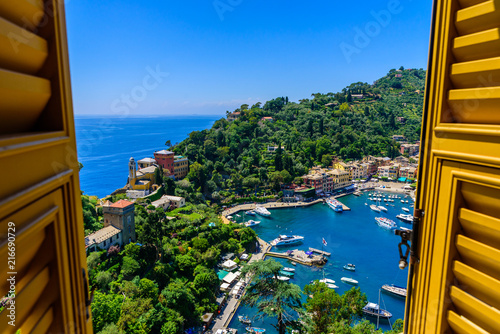 Fotografie, Obraz Portofino, Italy - colorful houses and yacht in little bay harbor