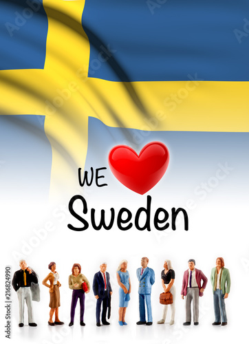 Wallpaper Mural we love Sweden, A group of people pose next to the swedish flag