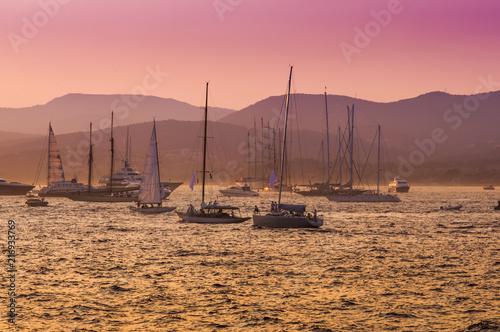 Fotografie, Obraz sail boats and yacht at sea sunset. Saint Tropez, France