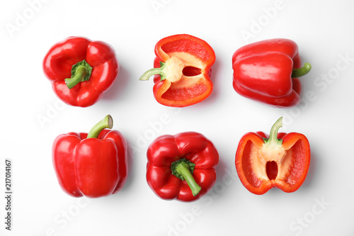 Flat lay composition with raw ripe paprika peppers on white background Fototapeta