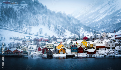 фотография wooden houses on the banks of the Norwegian fjord, beautiful mountain landscape