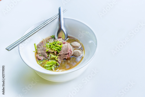 Beef noodles with braised beef and meatball delicious Chinese style Asian favorite Thai street food on white background