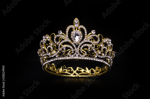 gold crown with diamonds isolated on black