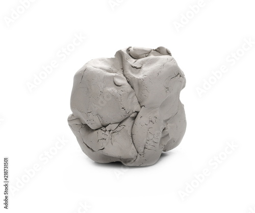 Grey modelling clay ball, lump isolated on white background